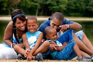 Family of four playing